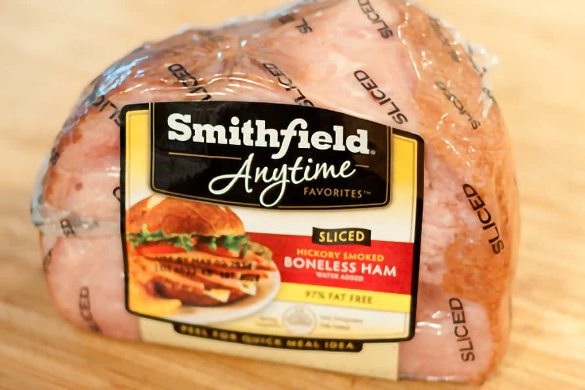 Smithfield Anytime boneless ham packaged sitting on a cutting board