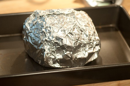 Foil wrapped ham ready for warming