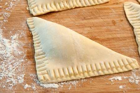 Crimp the edges of Easy Peach Turnovers with a fork