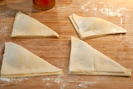 Fold squares to make triangles for Easy Peach Turnovers