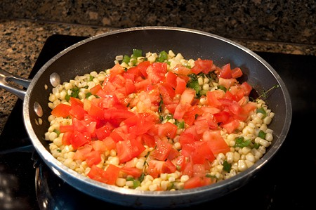Add diced tomato to Sweet Corn Salad with Seared Sea Scallops