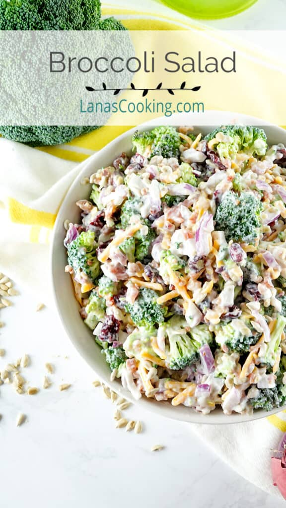 Finished broccoli salad in a white serving bowl.