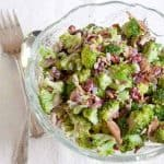 Broccoli salad featuring crisp, fresh broccoli florets, bacon, dried cranberries, and sunflower kernels with a sweet and tangy dressing. From @NevrEnoughThyme http://www.lanascooking.com/broccoli-salad/