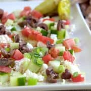 My Big Fat Greek Appetizer is layers of good olive oil, feta cheese, cucumber, green onion, tomatoes, and Kalamata olives. Scoop it up with a pita! https://www.lanascooking.com/big-fat-greek-appetizer