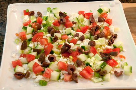 Add tomatoes and diced Kalamata olives to My Big Fat Greek Appetizer