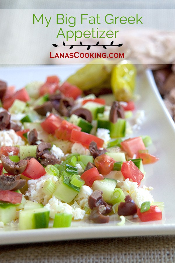 My Big Fat Greek Appetizer is layers of good olive oil, feta cheese, cucumber, green onion, tomatoes, and Kalamata olives. Scoop it up with a pita! From @NevrEnoughThyme https://www.lanascooking.com/big-fat-greek-appetizer