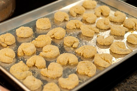 Coated shrimp on baking pan ready for the oven