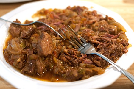 Shred the beef for Slow Cooker Shredded Beef Tacos