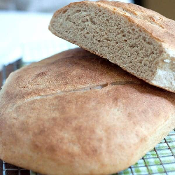Step-by-step recipe for Whole Wheat Sourdough Bread along with instructions for making a sourdough starter with wild yeast. From @NevrEnoughThyme https://www.lanascooking.com/whole-wheat-sourdough-bread/