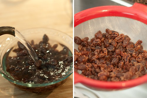 Raisins in a small bowl with boiling water poured over.