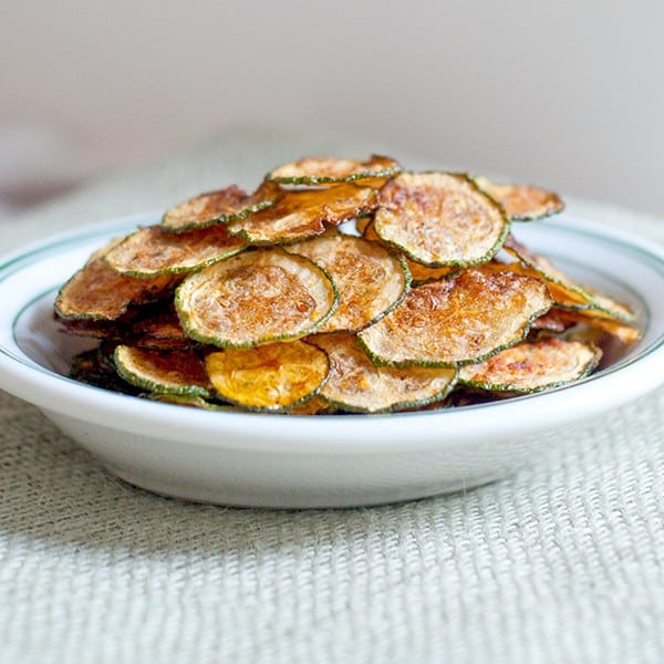 Zucchini Chips - very thinly sliced zucchini baked until brown and crispy. From @NevrEnoughThyme http://www.lanascooking.com/zucchini-chips
