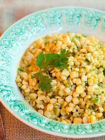 This recipe for Curried Corn combines fresh corn kernels with butter, cream, curry, and cilantro in an old, traditional deep south dish. Great for cookouts or dinner parties. From @NevrEnoughThyme https://www.lanascooking.com/curried-corn/
