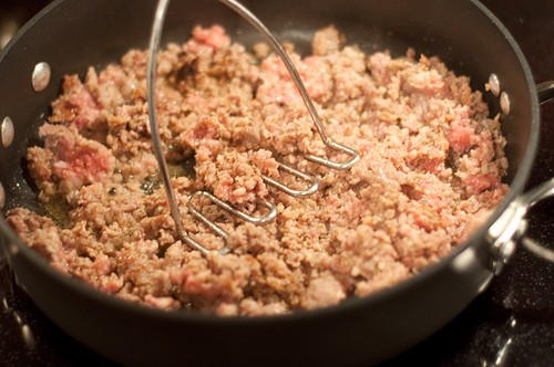 Sausage cooking in skillet to make sausage cheese bisquick muffins