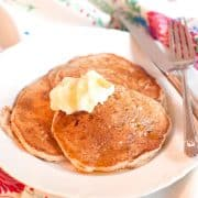 Spiced Pear Pancakes - a whole wheat pancake batter with grated fresh pear spiced with cardamom and ginger. Perfect for the weekend. https://www.lanascooking.com/spiced-pear-pancakes/
