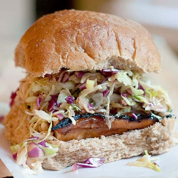 Asian Style Barbecue Chicken Sandwich - chicken breasts are marinated with Asian flavors, then grilled and topped with an Asian style coleslaw. From @NevrEnoughThyme https://www.lanascooking.com/asian-style-barbecue-chicken-sandwich/
