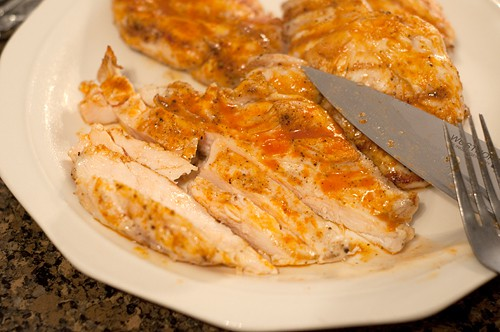 Slice cooked chicken for Grilled Buffalo Chicken Wrap