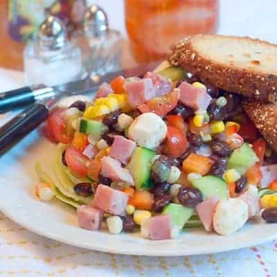 Ham and Black Bean Summer Salad - celebrate the end of the season with this delicious protein-rich main dish salad with fresh corn and tomatoes. From @NevrEnoughThyme https://www.lanascooking.com/ham-black-bean-summer-salad/