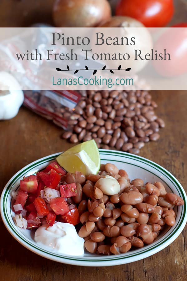 Pinto Beans with Fresh Tomato Relish - easy and simple recipe for traditional pinto beans. Served with a fresh tomato relish, sour cream, and lime wedges. https://www.lanascooking.com/pinto-beans-fresh-tomato-relish/