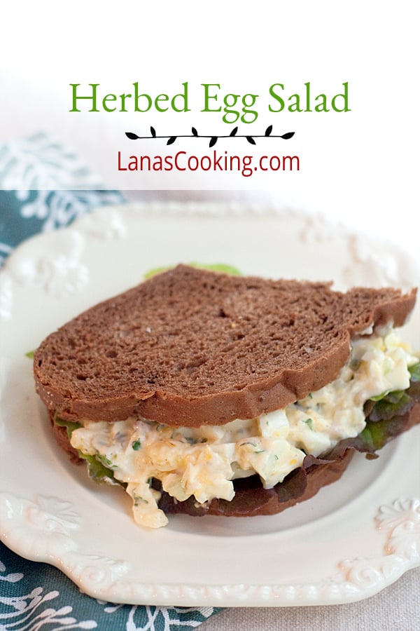 This herbed egg salad is full of flavor with the bright and bold fresh herbs, capers, red onion, and celery. No bland eggs here! From @NevrEnoughThyme https://www.lanascooking.com/herbed-egg-salad/