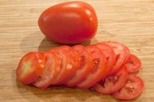 Slice tomatoes for Potato, Spinach, and Tomato Gratin