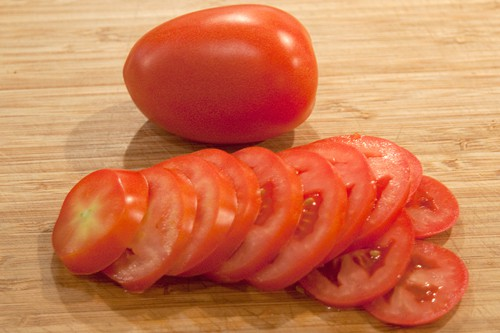 Slice tomatoes for Potato, Spinach, and Tomato Gratin