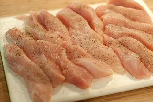 Seasoning chicken strips for Nana's Chicken Fingers