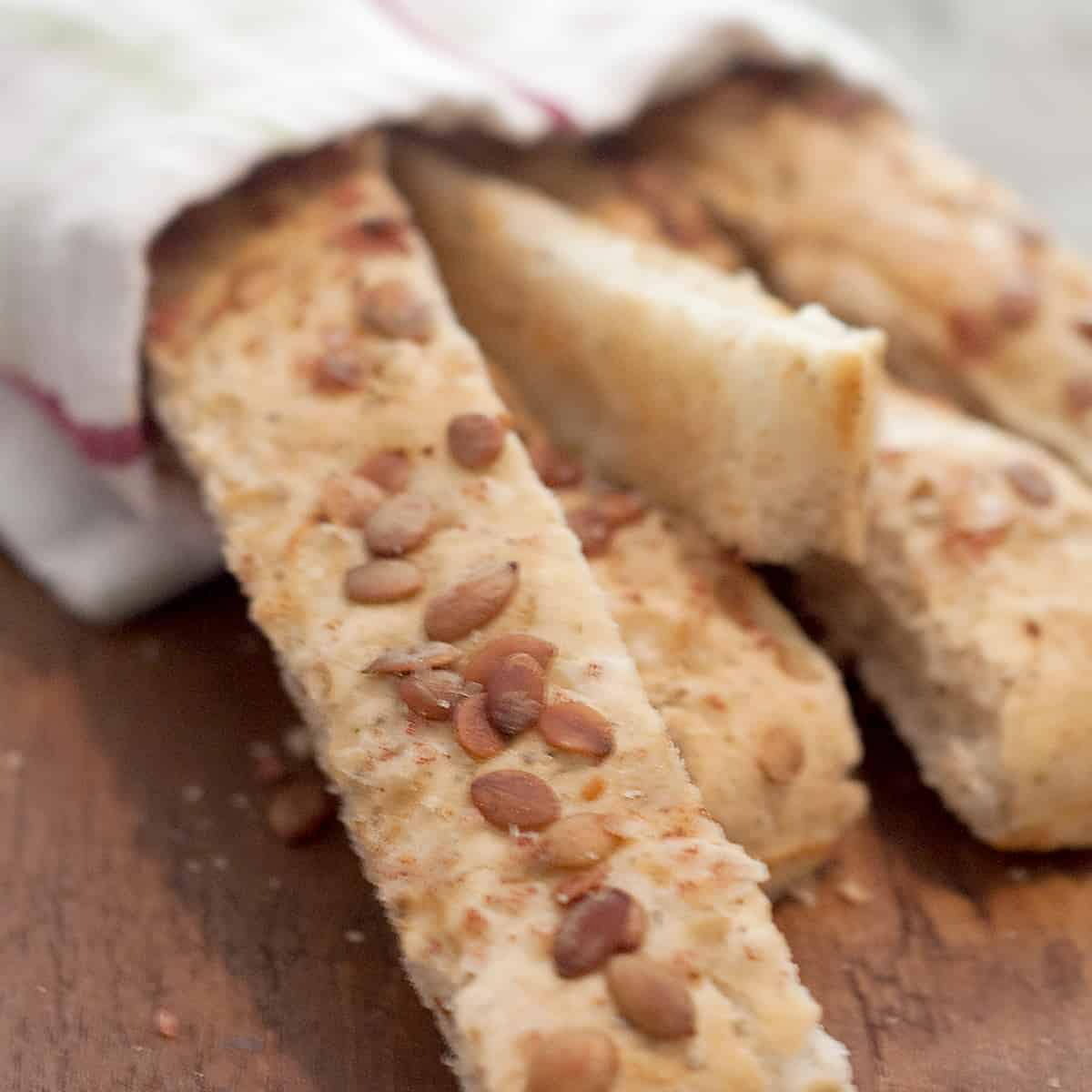 Pumpkin Seed Breadsticks - delicious savory breadsticks with Italian seasoning and topped with roasted, salted pumpkin seeds. From @NevrEnoughThyme https://www.lanascooking.com/pumpkin-seed-breadsticks/