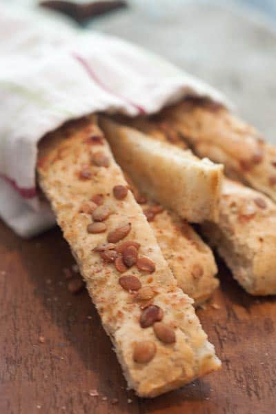 Pumpkin seed breadsticks - savory breadsticks with Italian seasoning and topped with roasted, salted pumpkin seeds. From @NevrEnoughThyme http://www.lanascooking.com/pumpkin-seed-breadsticks/