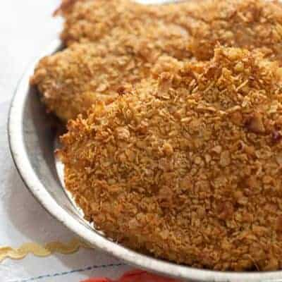 """Skinny Fried Chicken- chicken coated with tangy buttermilk, herbs, spices, and crispy corn flake crumbs. Cut the fat with this oven baked """"fried"""" chicken. From @NevrEnoughThyme https://www.lanascooking.com/skinny-fried-chicken"""