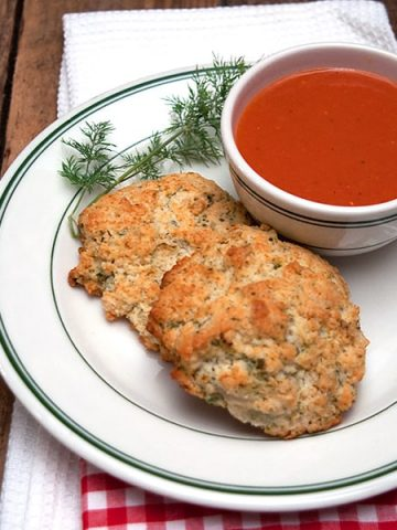 Easy Herbed Drop Biscuits flavored with fresh dill and chives. A great accompaniment for your winter soups and stews. https://www.lanascooking.com/herbed-drop-biscuits/