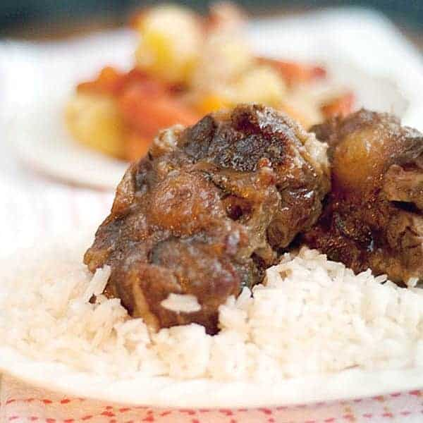 My Oxtail Stew is cooked low and slow with carrots, onions, and spices then served over hot, fluffy rice. From @NevrEnoughThyme http://www.lanascooking.com/oxtail-stew