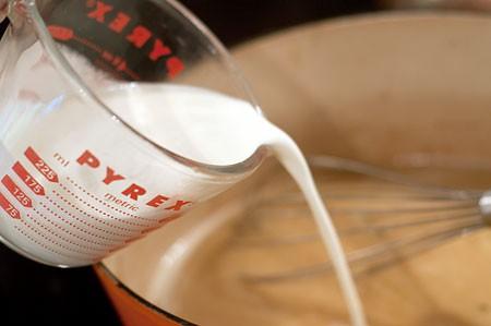 Stir in cream to Pork Loin with Creamy Celery Sauce