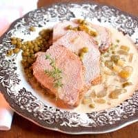 Pork Loin with Creamy Celery Sauce - A lovely pork loin served with a luscious creamy celery sauce is perfect for a special occasion dinner. From @NevrEnoughThyme https://www.lanascooking.com/pork-loin-creamy-celery-sauce/