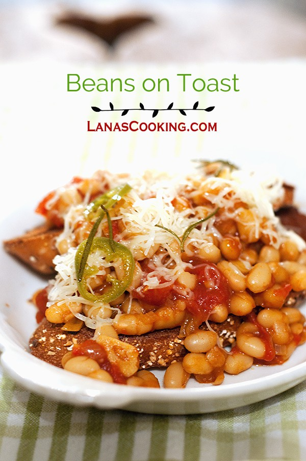 English style beans on toast. Baked beans served over toasty whole grain bread topped with Cheddar cheese. From @NevrEnoughThyme https://www.lanascooking.com/beans-toast/