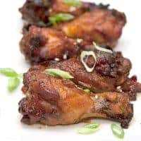 Slow Cooker Asian Style Wings with ginger, soy sauce, and Sriracha are a fantastic appetizer for any occasion from football party to apres ski. From @NevrEnoughThyme https://www.lanascooking.com/slow-cooker-asian-style-wings/