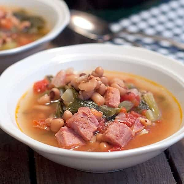 This Creole Black Eyed Pea Soup includes the trinity along with ham, chicken stock, seasonings, and fresh greens for some southern goodness in a pot. From @NevrEnoughThyme https://www.lanascooking.com/creole-black-eyed-pea-soup/