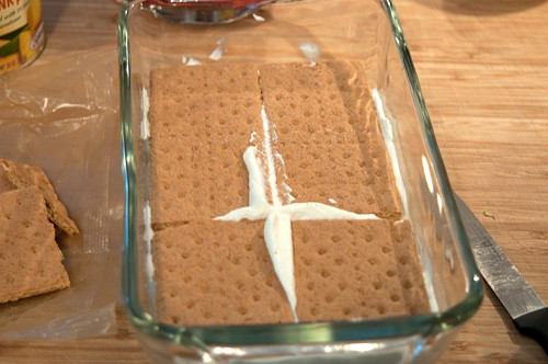 Graham crackers layered for Banana Split Icebox Cake