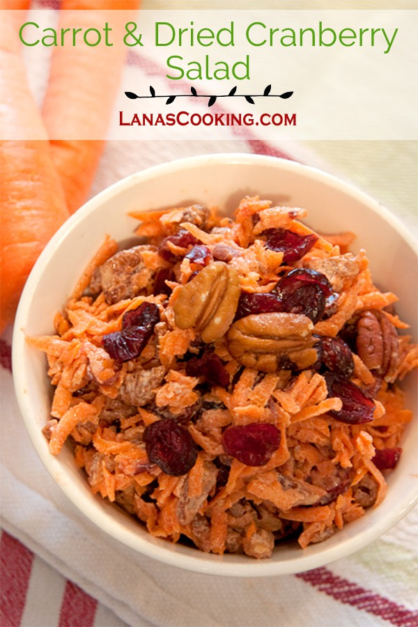 Carrot and Dried Cranberry Salad with vanilla yogurt and toasted pecans. From @NevrEnoughThyme http://www.lanascooking.com/carrot-and-dried-cranberry-salad