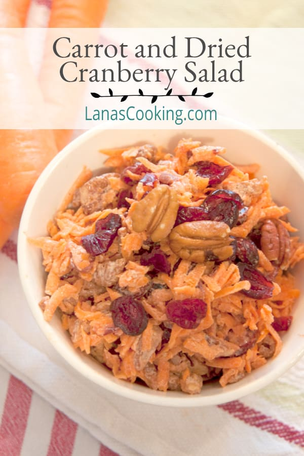 This Carrot and Dried Cranberry Salad updates the standard recipe with dried cranberries, vanilla yogurt, and toasted pecans. From @NevrEnoughThyme https://www.lanascooking.com/carrot-and-dried-cranberry-salad/