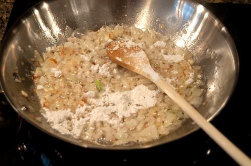 Add flour to pan for tomato gravy