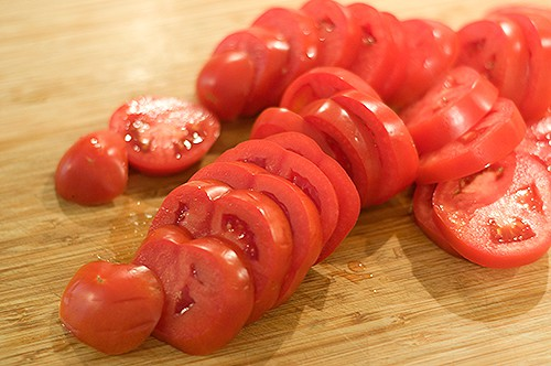 Slice tomatoes for Oven Roasted Tomatoes in Oil