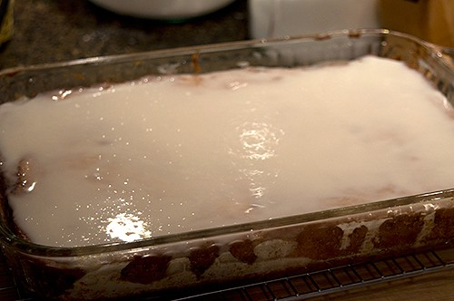Glazed honey bun cake on cooling rack