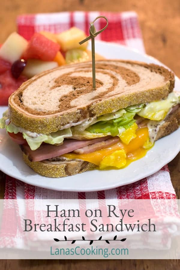 This Ham on Rye Breakfast Sandwich is a great option for a hearty breakfast. This will definitely keep you going strong until lunchtime and beyond. From @NevrEnoughThyme https://www.lanascooking.com/ham-on-rye-breakfast-sandwich/