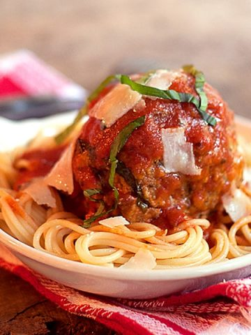 My recipe for Jumbo Meatballs and Spaghetti will be a favorite with your family! Treat your family and friends to a delicious and fun dinner! From @NevrEnoughThyme https://www.lanascooking.com/jumbo-meatballs-and-spaghetti/