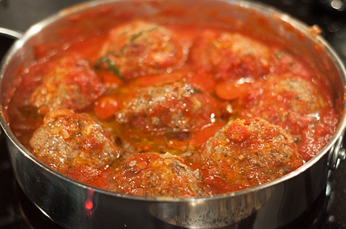 Add browned meatballs to tomato sauce