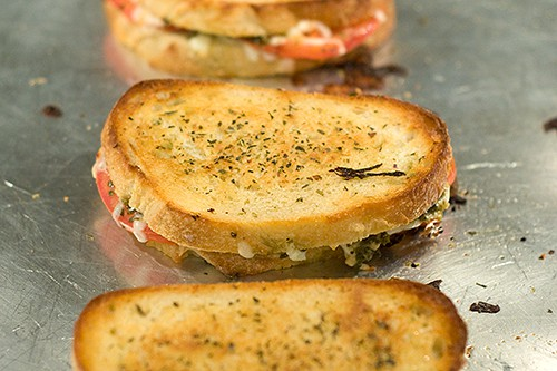 Golden brown sandwiches on a baking sheet