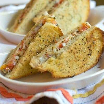 Caprese Grilled Cheese Sandwich - everything you want from a classic Caprese Salad in a warm, toasty, grilled cheese sandwich. From @NevrEnoughThyme https://www.lanascooking.com/caprese-grilled-cheese/