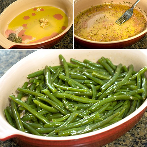 Green beans tossed with vinaigrette and placed in a baking dish.