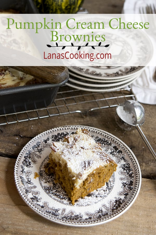 Pumpkin Cream Cheese Brownies - a pumpkin cake-like brownie with a swirled cream cheese layer. Great dessert for Thanksgiving dinner! From @NevrEnoughThyme https://www.lanascooking.com/pumpkin-cream-cheese-brownies
