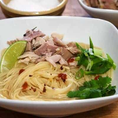 Asian Inspired Turkey Noodle Bowl - a brothy bowl of noodles using leftover Thanksgiving turkey, pasta, lime, hot chili sauce, cilantro, green onions, and soy sauce. From @NevrEnoughThyme https://www.lanascooking.com/turkey-noodle-bowl/